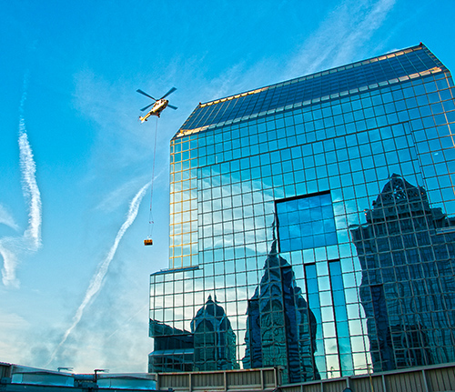 Helicopter lifting services - Heli crane in city, urbain lifting helicopter operation