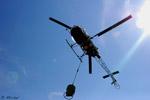 LAMA SA 315 B F-HCRB de la société Pagés Hélicoptère avec le soleil
