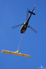 Départ avec une charge sous l'hélicoptère