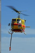 Bell 205 en présentation pour un posé